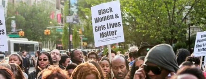 Protestors holding sign that says Black Women and Girls Lives Matter