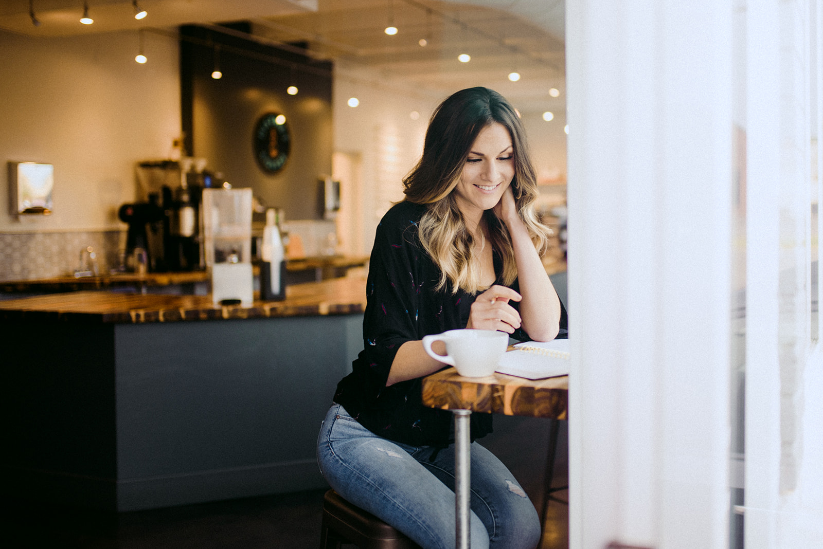woman smiling at coffee bar