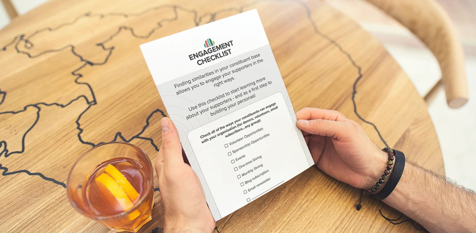 person holding copy of donor engagement checklist