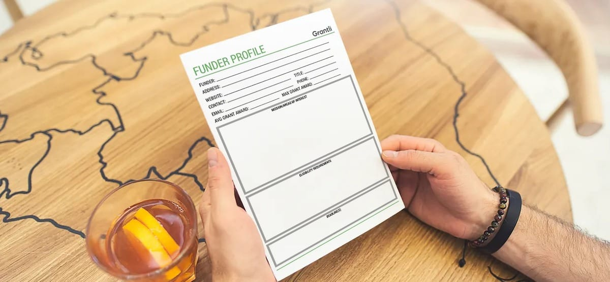 Person holding a Funding Profile worksheet to help get funding for nonprofit