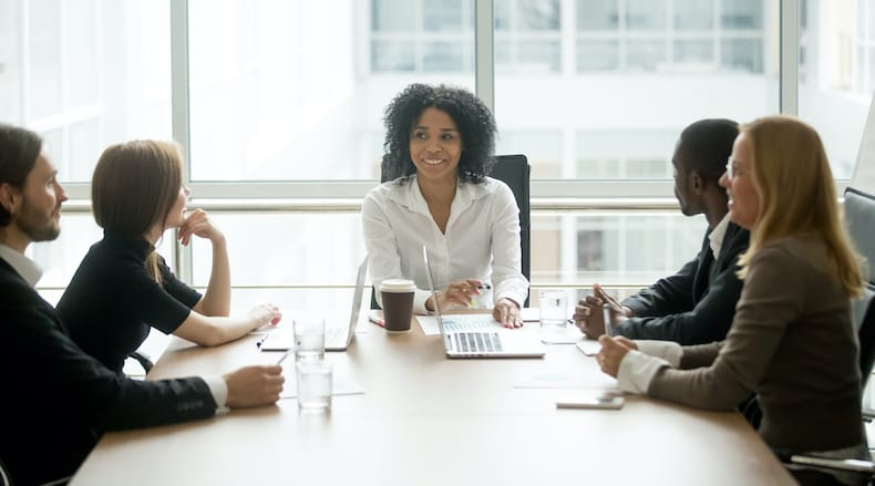 Header image for nonprofit leadership best practices showing leader at head of conference table