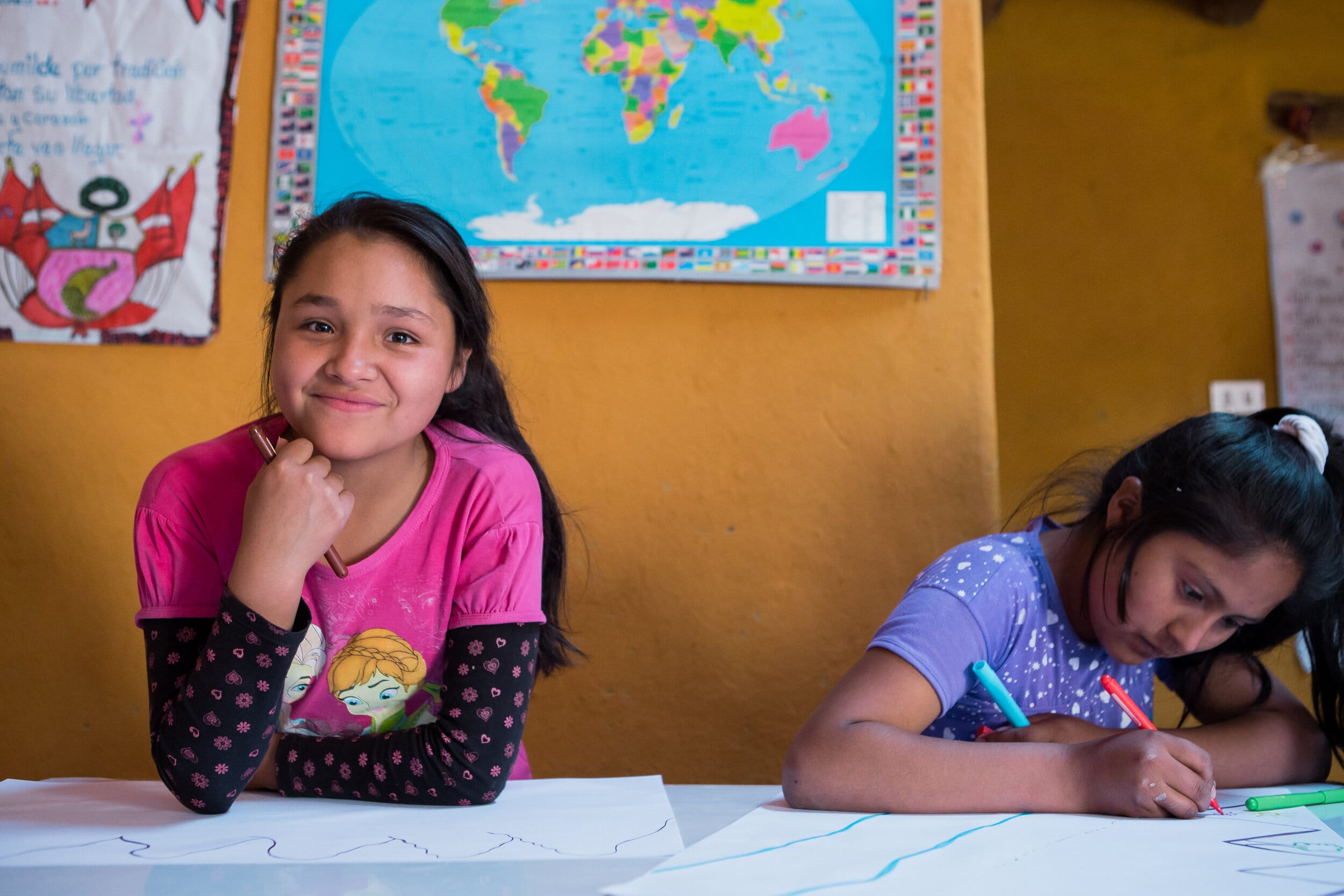 shes the first impact image showing two girls in classroom
